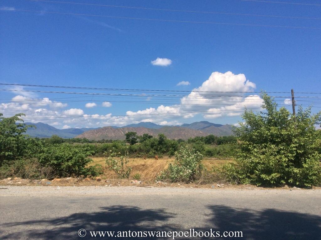 mountains in the distance, saigon to hanoi, vietnam